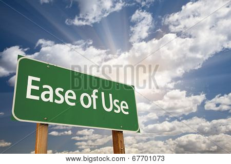 Ease of Use Green Road Sign with Dramatic Clouds and Sky.