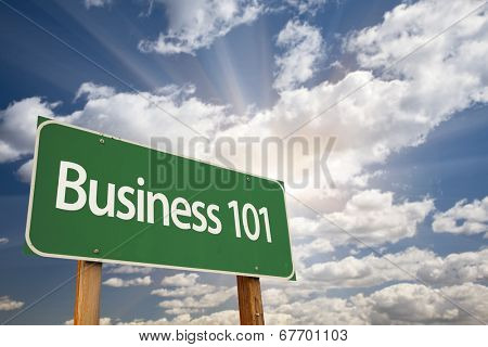 Business 101 Green Road Sign with Dramatic Clouds and Sky.
