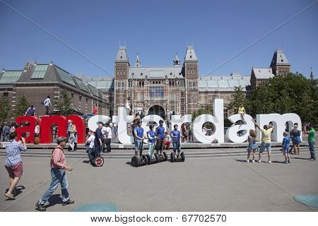 Tourists And Segways near Rijksmuseum Amsterdam