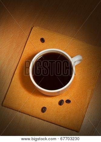 A White Coffee Cup On A Napkin