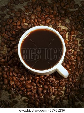 A Cup Of Coffee And Coffee Beans On Sacking