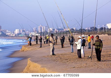 Many People Fishing On Blue Lagoon Beach