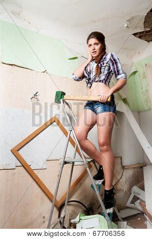Attractive brunette woman with sledge hammer