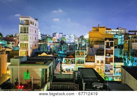 HO CHI MINH, VIETNAM - APRIL 28, 2014: Night view of one of the oldest neighborhoods in Ho Chi Minh City. Its formerly named Saigon, which was officially renamed Ho Chi Minh City July 2, 1976
