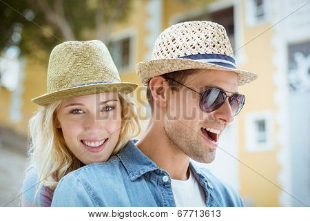 Hip young couple spending time together on a sunny day in the city