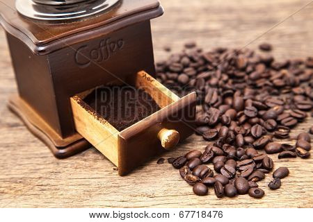 Vintage Coffee Bean Grinder And Fresh Ground Coffee