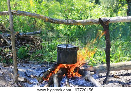 Smoked tourist kettle on camp fire