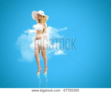 Pretty girl in swimming suit and hat against color background