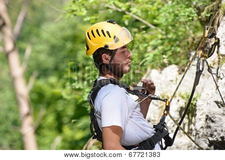 Steeplejack Climbing A Rock Wall