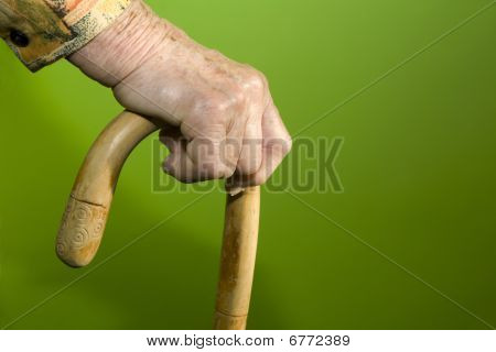 hand of old woman with stick