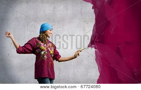 Young girl painter with brush wearing bandana