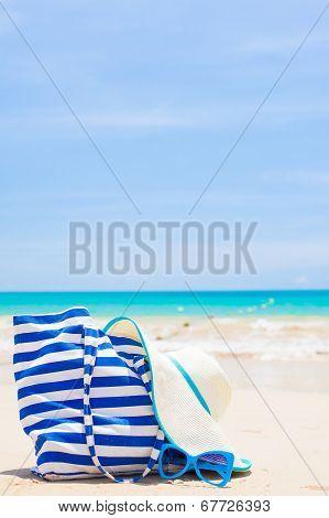 beach bag, sunglasses and hat at tropical beach. Thailand, Khao Lak