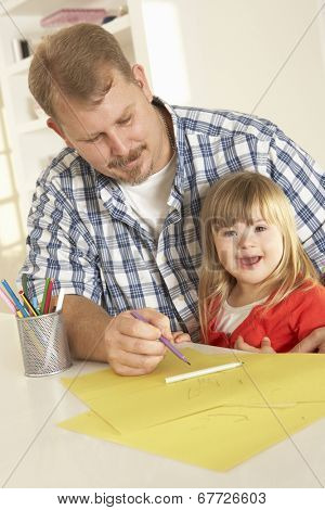 Father and Downs Syndrome daughter drawing