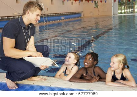 Girls having swimming lesson