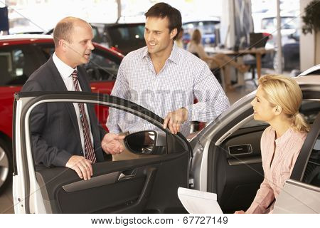 Couple buying new car