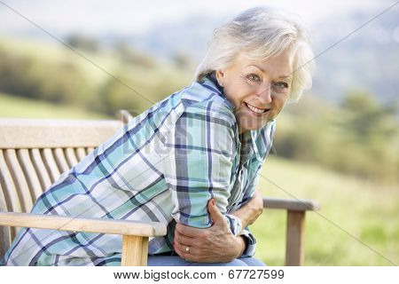 Senior woman sitting outdoors