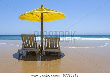 Beach Chairs With Umbrella On A Sunny Day