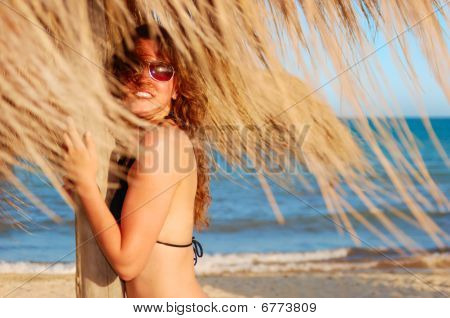 Woman On A Beach Under Parasol