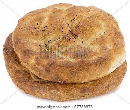 Turkish pita called ramazan pidesi isolated on white background