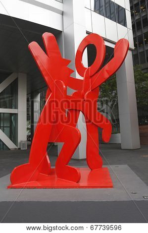 Figure balancing on dog by Kieth Haring in Manhattan