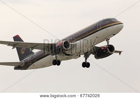 Departing Royal Jordanian Airbus A320-232 aircraft in the rainy day