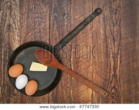 vintage set for frying eggs over wooden table, space for your text