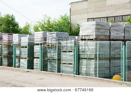 Packed Cinder Blocks Outdoors In Racks