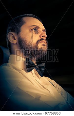 Man with Monocle and Bowtie Retro Portrait