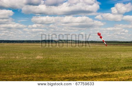 Aerodrome With A Weather Vane. Blue Sky With White Clouds