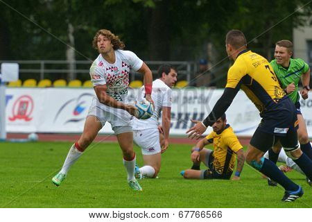 MOSCOW, RUSSIA - JUNE 28, 2014: Daniel Bibby of England make pass in the match with Romania during the FIRA-AER European Grand Prix Series. England won 45-0