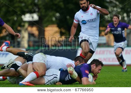 MOSCOW, RUSSIA - JUNE 29, 2014: Match for place 3 between Georgia and Scotland (blue uniforms) during the FIRA-AER European Grand Prix Series. Scotland won 38-12
