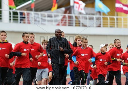 ZHUKOVSKY, MOSCOW REGION, RUSSIA - JUNE 27, 2014: IAAF World Champion Wilson Kipketer of Denmark gives a master class for young Russian athletes during the Znamensky Memorial