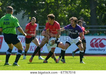 MOSCOW, RUSSIA - JUNE 29, 2014: Quarter final match between Scotland (blue uniform) and Belgium during the FIRA-AER European Grand Prix Series. Scotland won 17-12