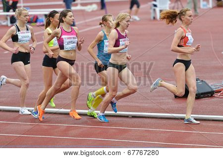 ZHUKOVSKY, MOSCOW REGION, RUSSIA - JUNE 27, 2014: Female athletes in the women 5000 meters during Znamensky Memorial. The competitions is one of the European Athletics Outdoor Classic Meetings