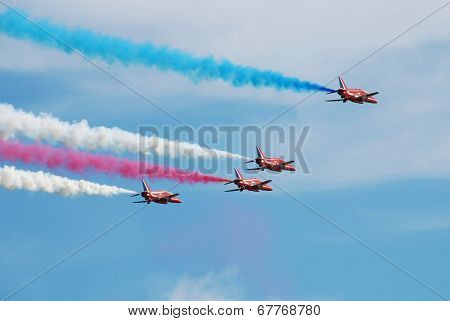 EASTBOURNE, ENGLAND - AUGUST 15, 2013: RAF aerobatic display team The Red Arrows perform at the Airbourne airshow at Eastbourne in East Sussex. The team were founded in 1965.
