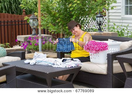 Grandmother Folding Her Granddaughters Clothes