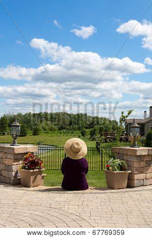 Grandma Gardener Taking A Break To Admire The View