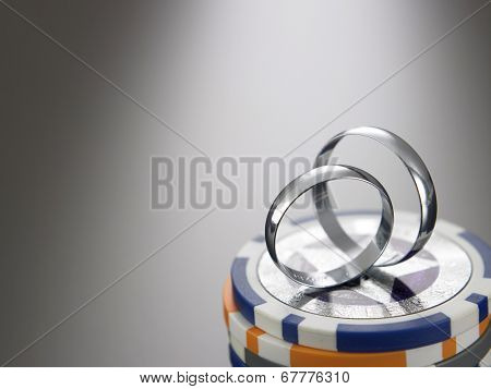 wedding ring on top of gamble chips