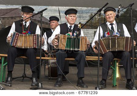 Three Men Playing Accordion