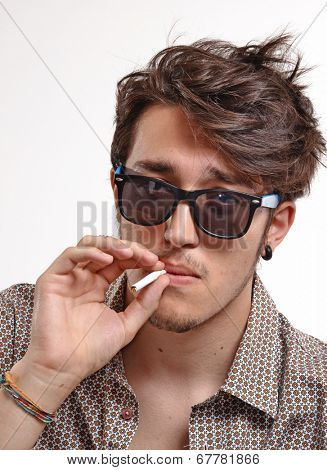 Smoking man portrait wearing sunglasses.