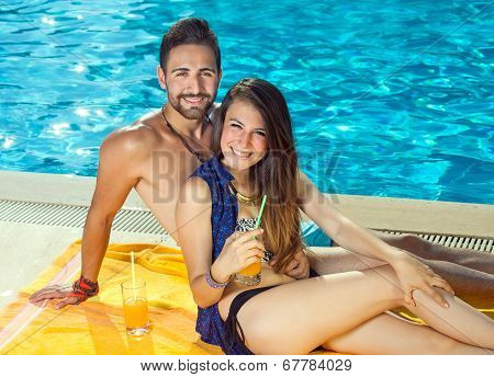 Beautiful Happy Couple Relaxing At A Pool