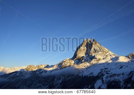 sunset on the western slope of the peak Midi d'Ossau, 2884 meters, Ossau Valley, Pyrenees, France