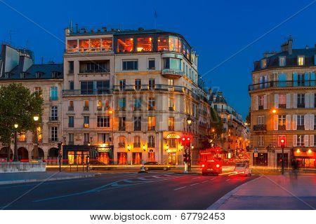 Parisian Restaurant Silver Tower In Night.