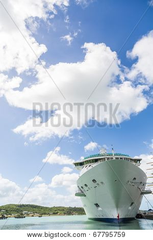 Cruise Ship Hull Under White Fluffy Clouds