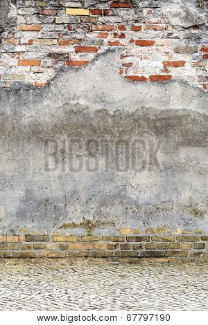 Old Plastered Red Brick Wall With Pavement