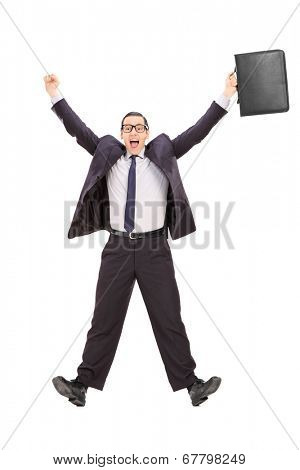 Full length portrait of an overjoyed businessman shot in mid-air isolated on white background