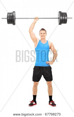 Full length portrait of a strong guy holding a barbell in one hand isolated on white background