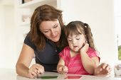 stock photo of handicap  - Downs Syndrome girl having speech therapy - JPG