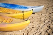 stock photo of kayak  - A group of kayaks on the beach - JPG