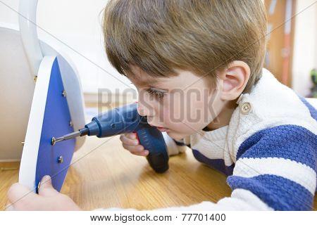 Little Boy Using Diy Tool